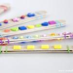 Manualidades caseras para niños: Armónicas con los palitos de helado