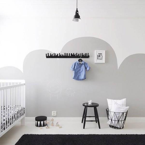 una idea genial para decorar paredes es la de hacer dibujos o formas con la pintura en este cuarto de beb de