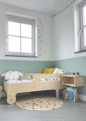 Una habitación infantil relajante en menta y blanco